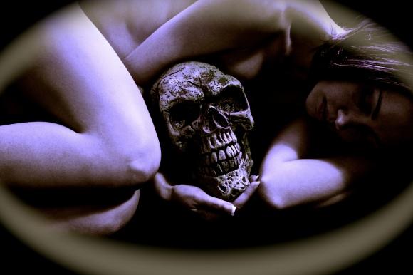 126517314-Woman nude holding skull